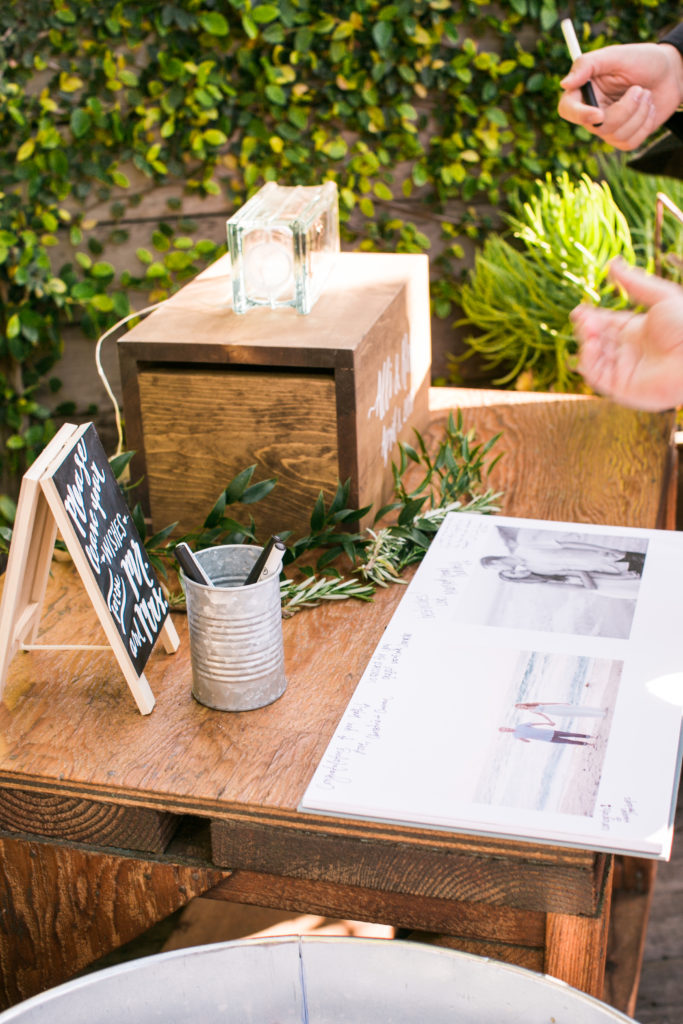 card box and guest book with plants