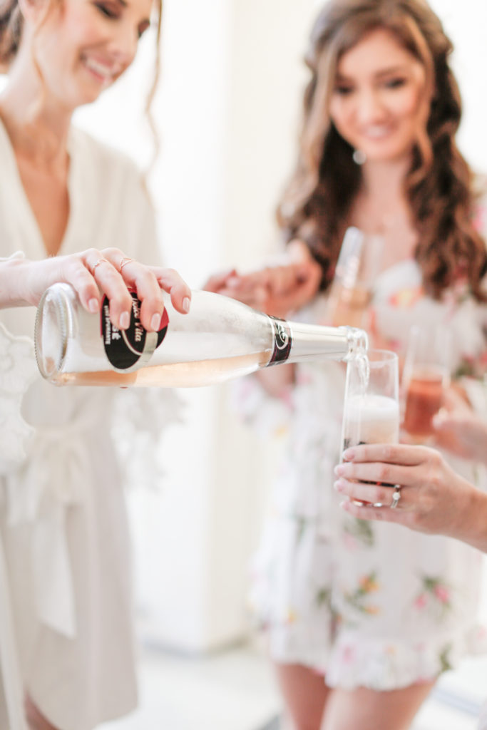 champagne with bridesmaids in rompers