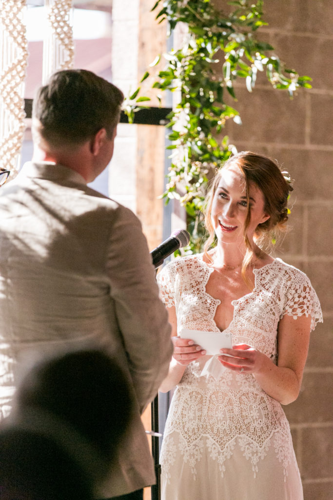 ceremony with macrame backdrop