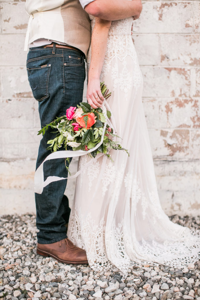 bright bouquet and bohemian wedding dress