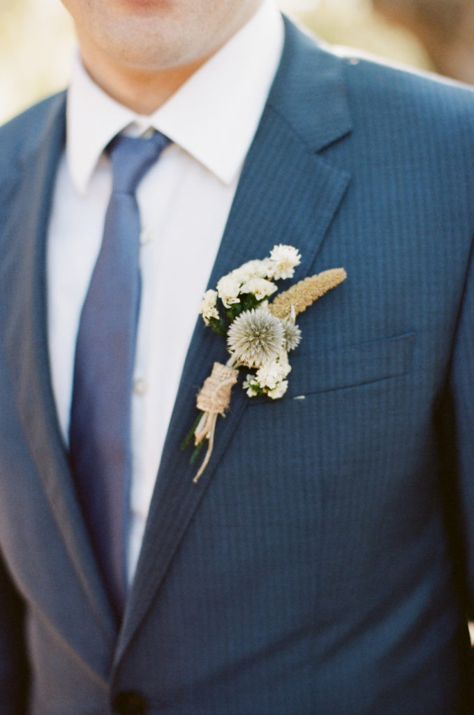 groom and dried flowers boutonniere