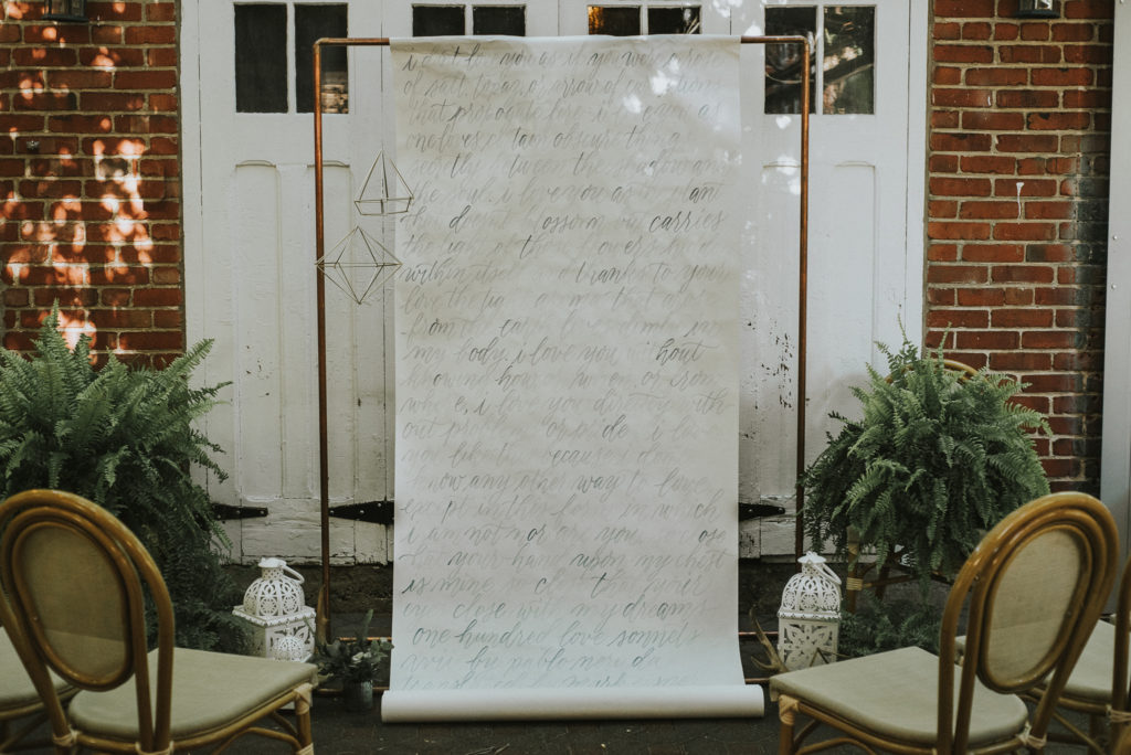 ceremony backdrop with handwritten vows and poems