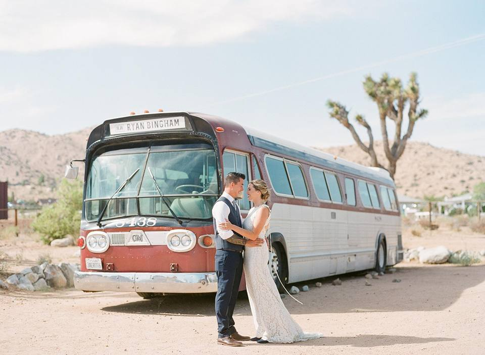 rimrock ranch desert wedding couple in front of vintage bus