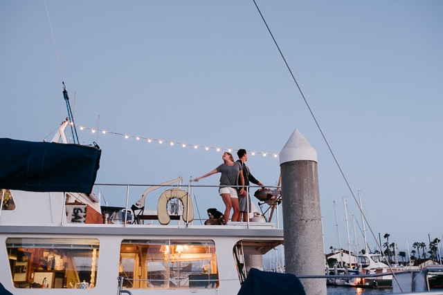 bistro lights on boat and dancing at sunset