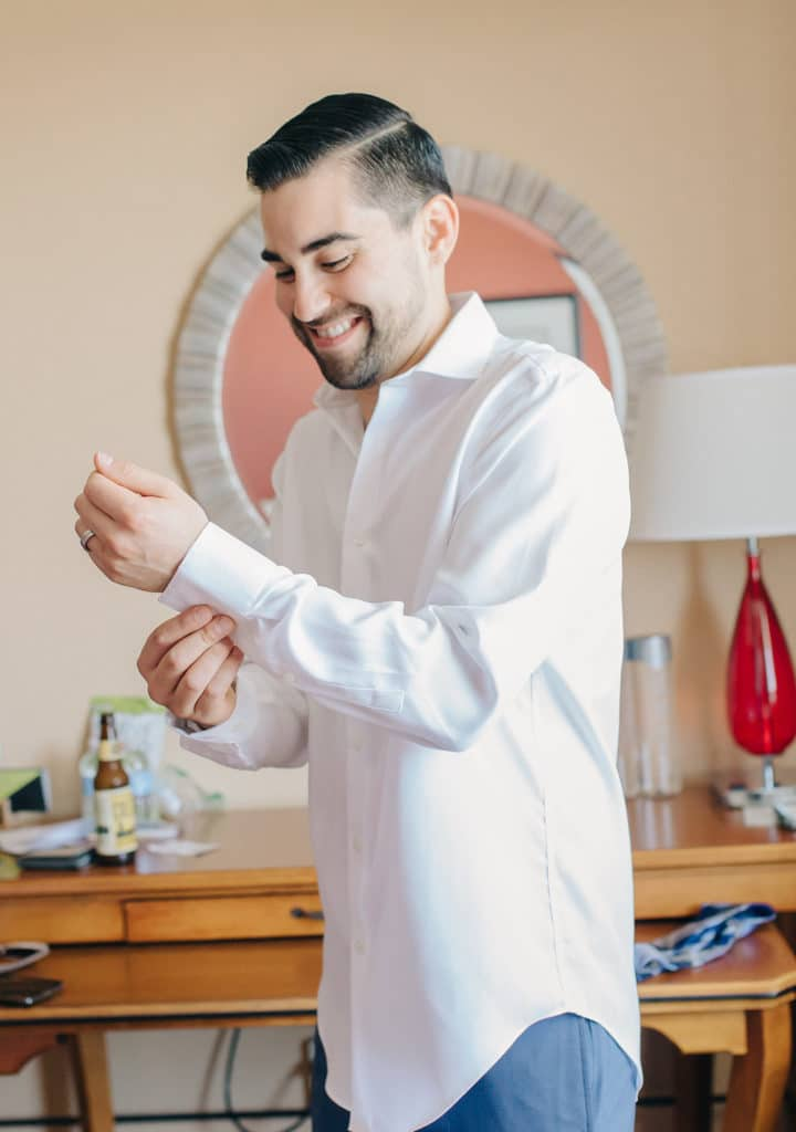 groom getting ready white shirt