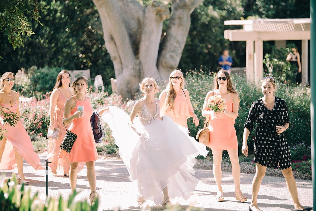 bride, bridesmaids and wedding planner getting ready for First Look