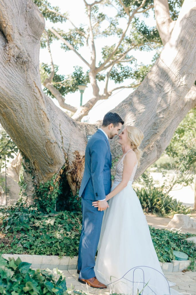 bride and groom under tree at south coast botanic garden for first look