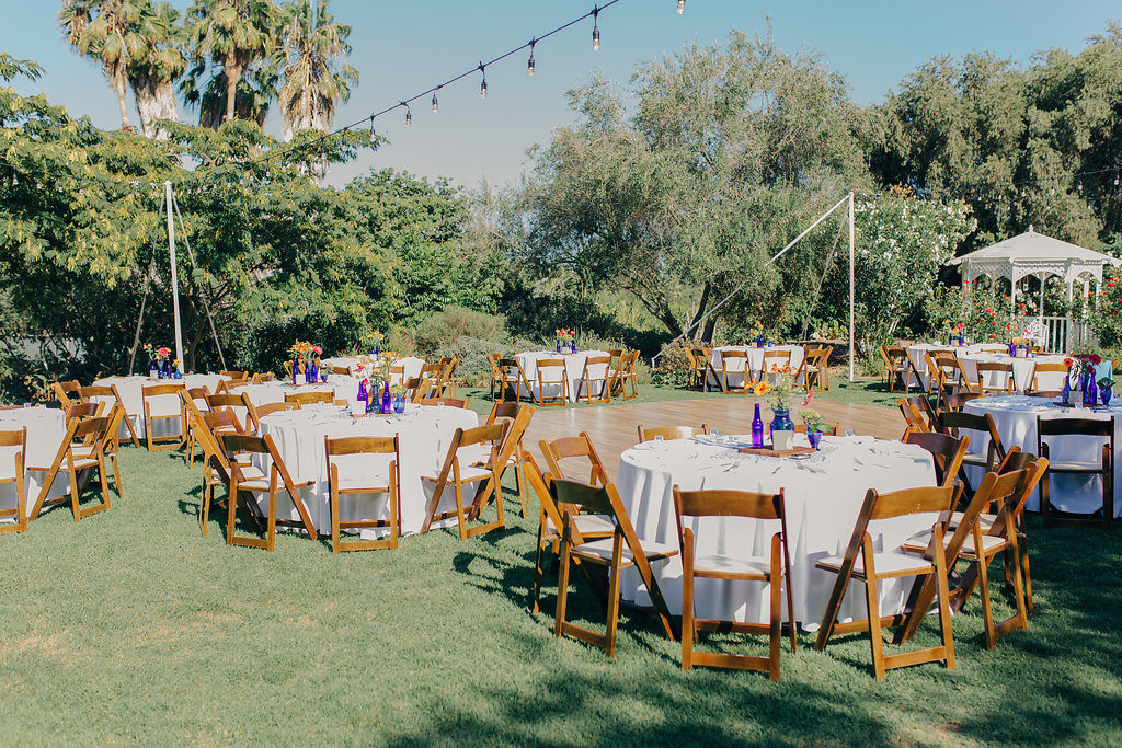round tables and wooden chairs for garden wedding