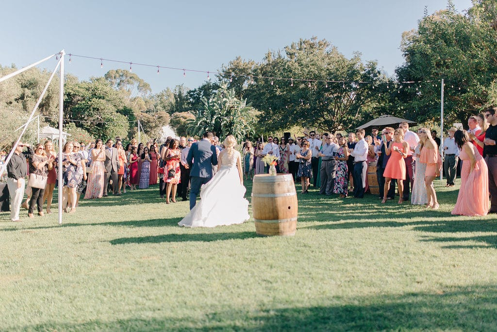 guests around bride and groom for grand entrance