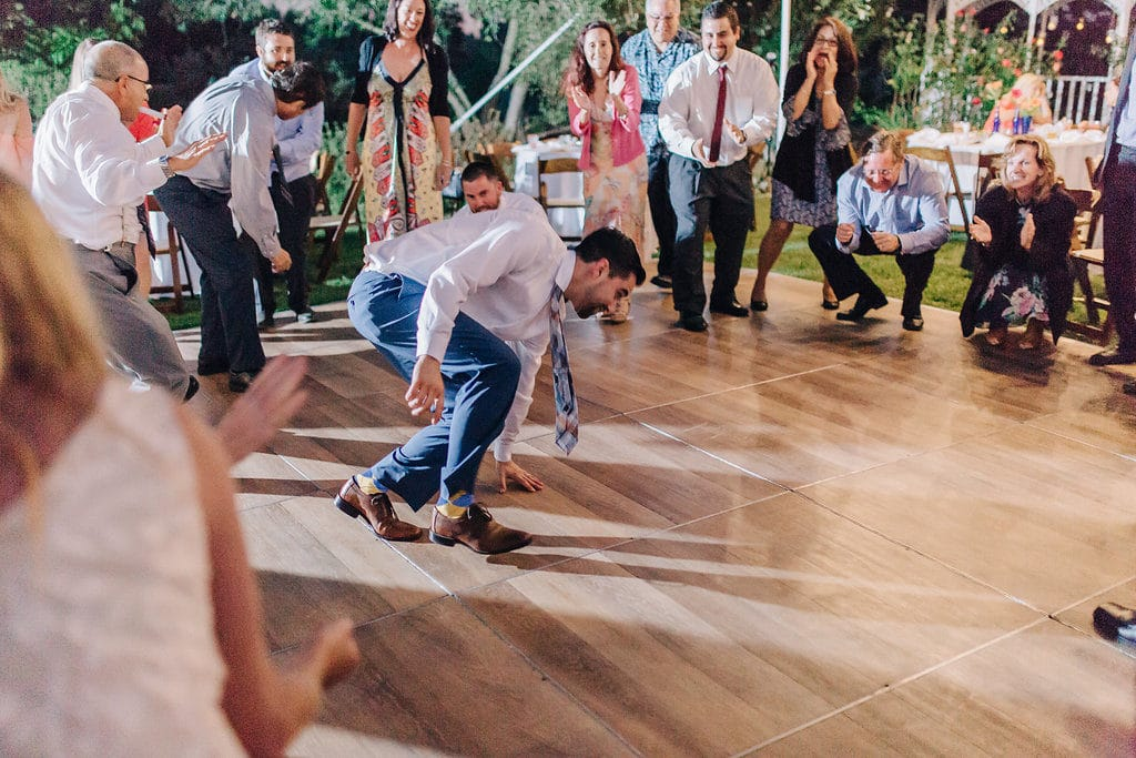 groom dancing at garden wedding