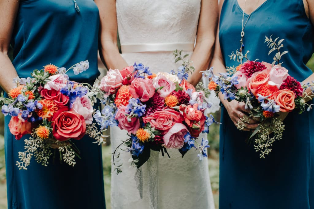 bride and bridesmaids bouquet bright pinks and oranges