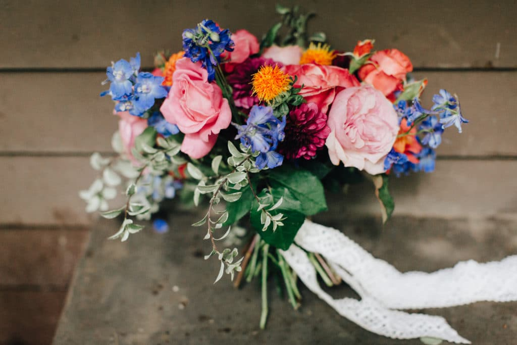 bridal bouquet with pinks oranges and purple wildflowers