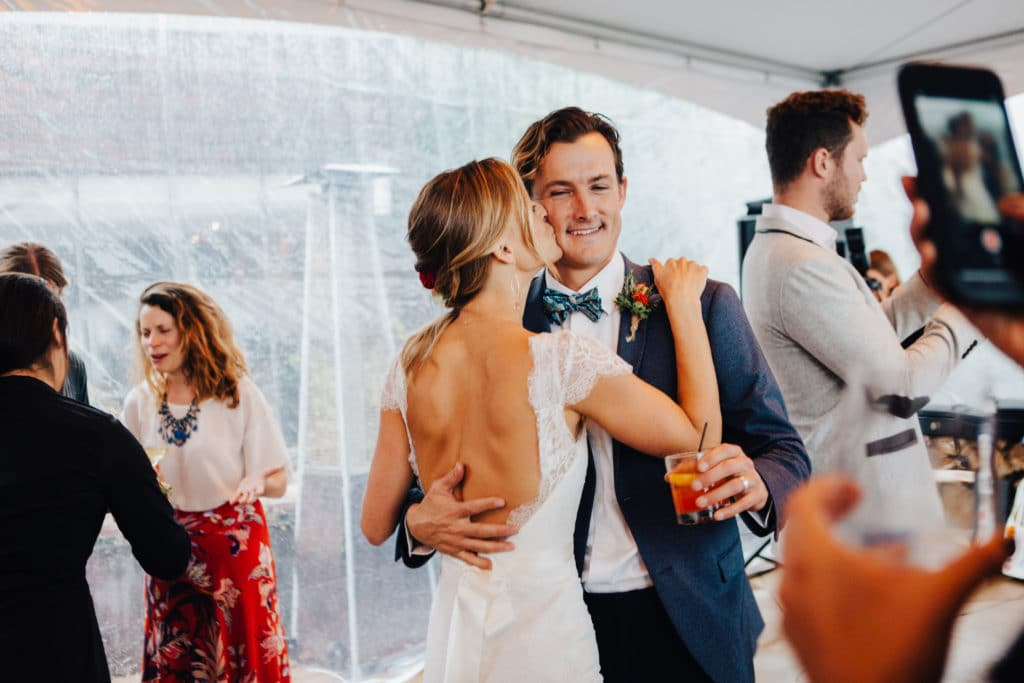bride and groom under clear tent dancing