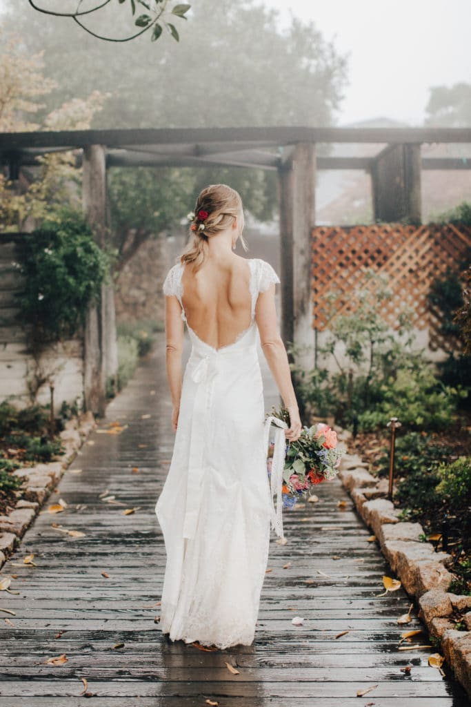 open back bridal gown and bright bouquet at Ventana Inn wedding