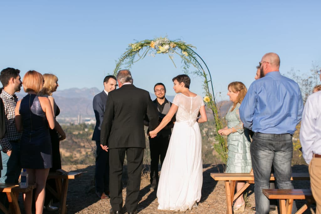 father walks bride down the aisle at TreePeople Park for intimate wedding in top of the mountain