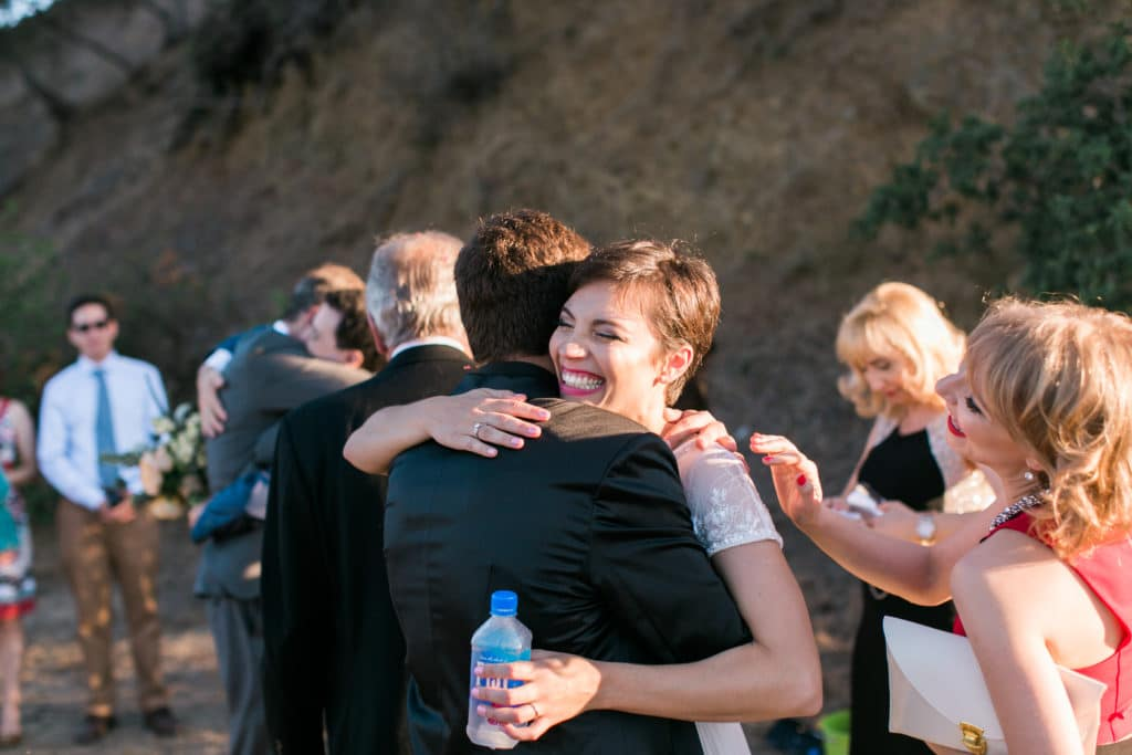 Bride hugging her guests at the intimate wedding on top of TreePeople Park in Los Angeles