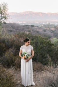short hair bride with flowy white gown. Bold pink lip for wedding at TreePeople park
