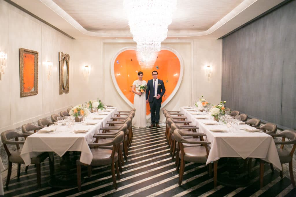 Wedding reception at Cecconi's west Hollywood. Very eclectic room with big orange heart and black and white floor