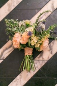 wedding bouquet with peach and yellow flowers