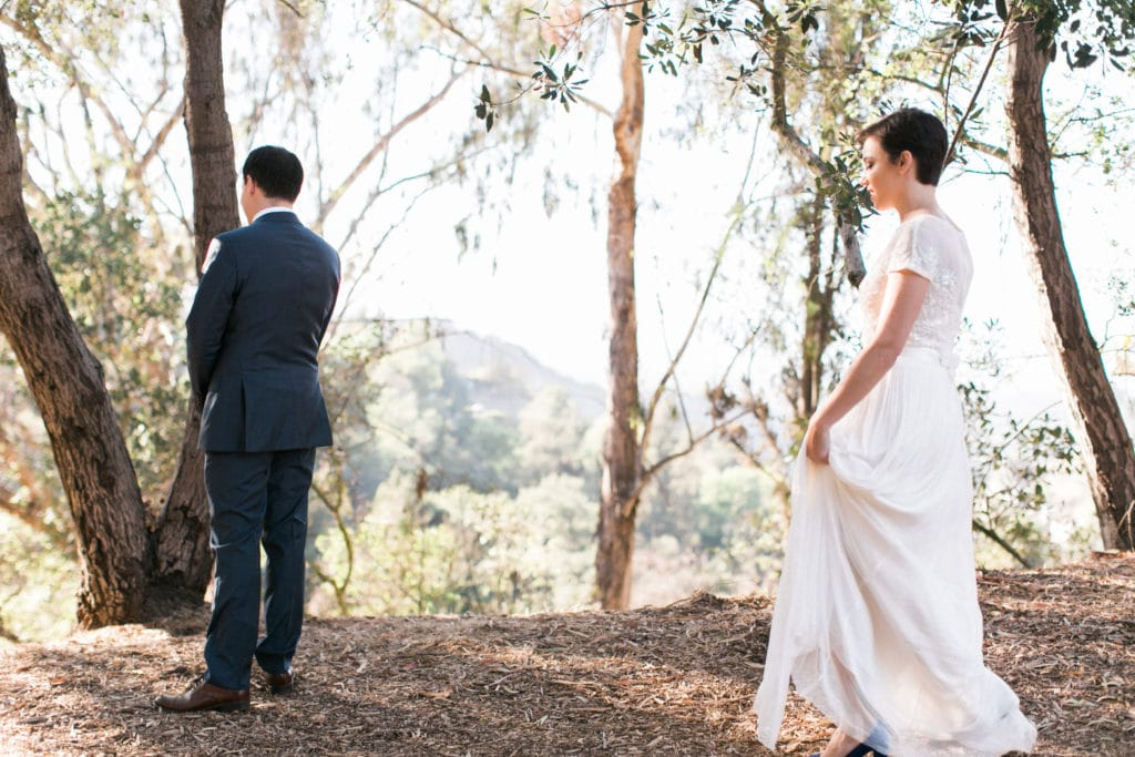 Bride walks up to groom for First Look at Tree People Park