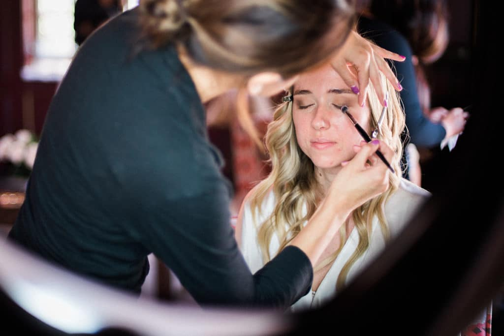 Emerald Monzon doing makeup on bride for fusion indian wedding in palos verdes