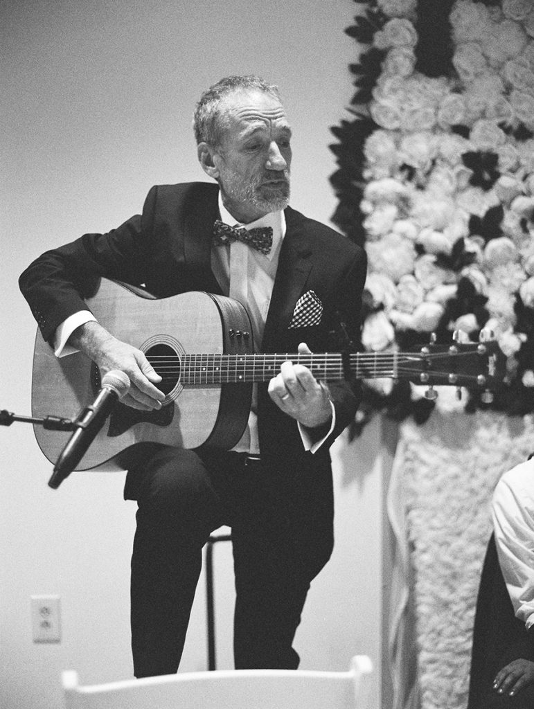 father of the bride playing guitar