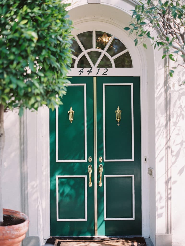 green door with trees on cute house in palos verdes