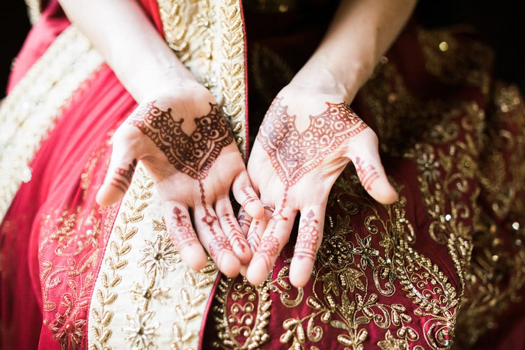 henna tattoo on bride's hands for hindu ceremony