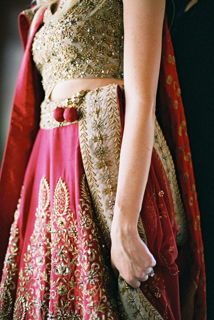 bride in red and gold traditional lehenga