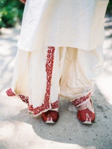 traditional indian groom wedding outfit red and white