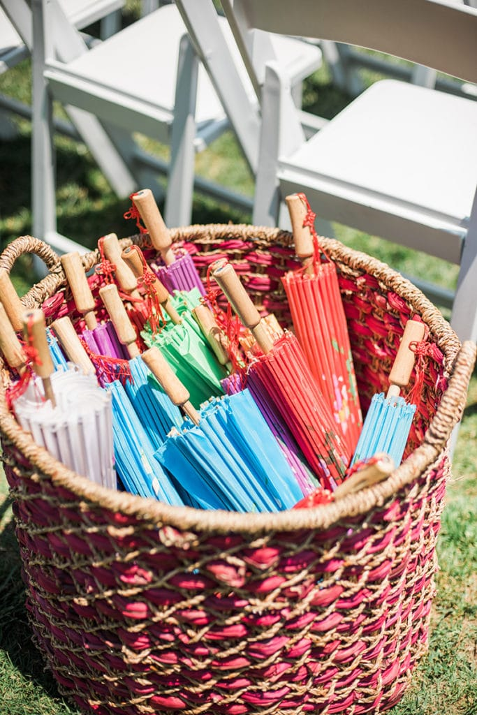 colorful umbrellas in red basket for ceremony in a garden