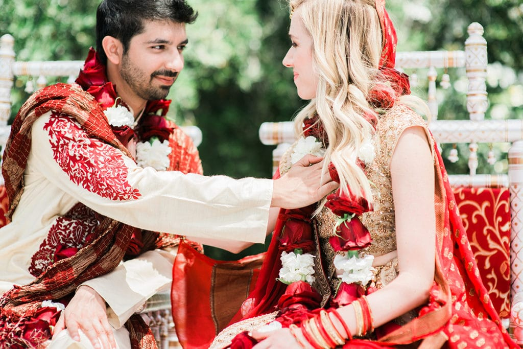 groom touches brides heart during hindu ceremony