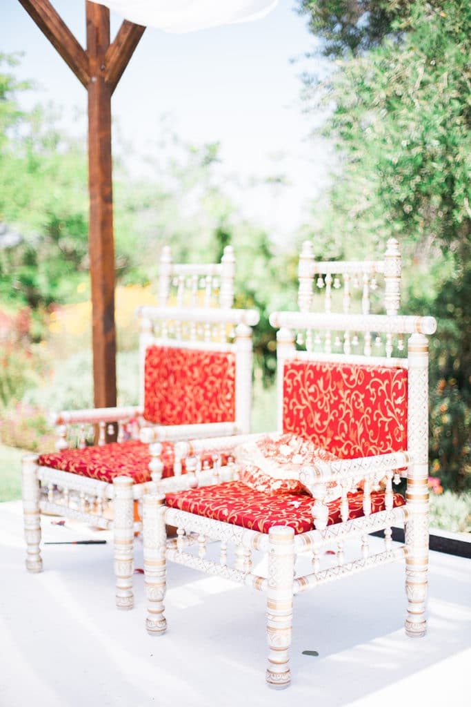 hindu ceremony chairs red and white under mandap at south coast botanic garden