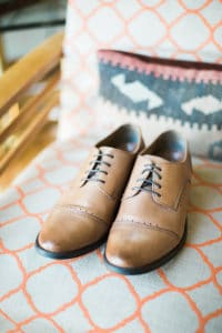 clean brown shoes and black laces for wedding