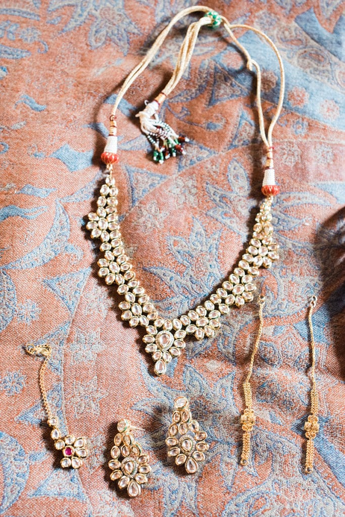 hindu ceremony jewelry for the bride gold and red