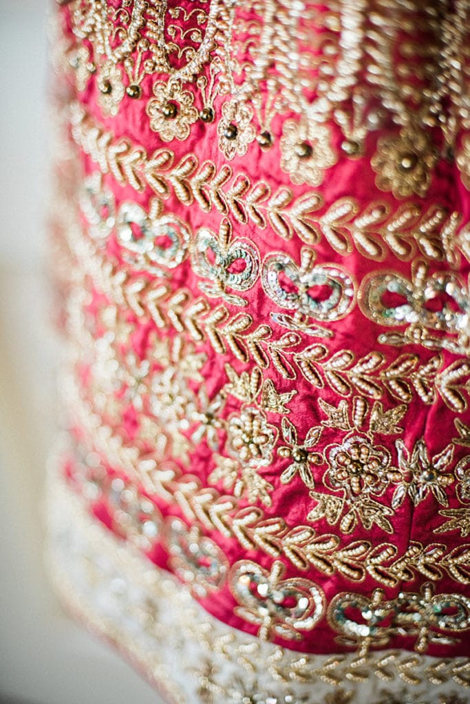 red and gold details on traditional lehenga