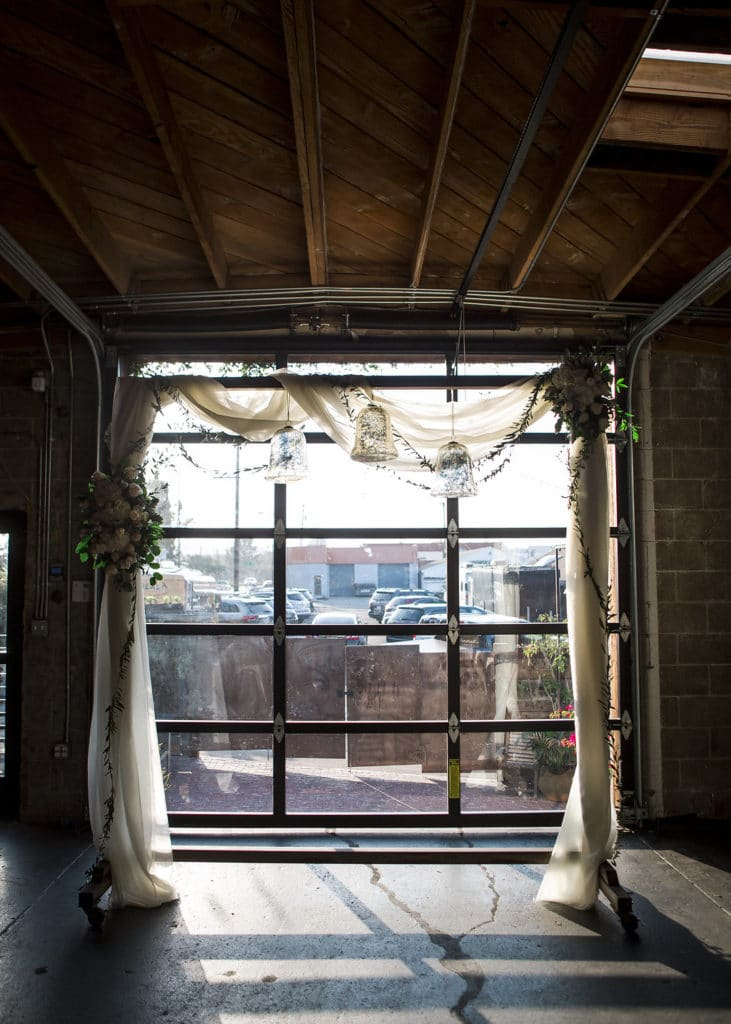 simple arch with fabric in front of window at smoky hollow studios