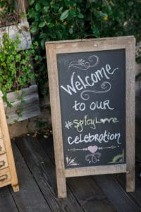 welcome sign for bride and groom on chalkboard