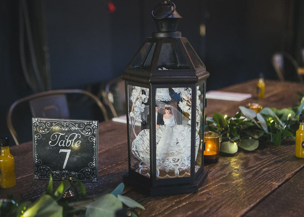 vintage cake topper in lantern as centerpieces