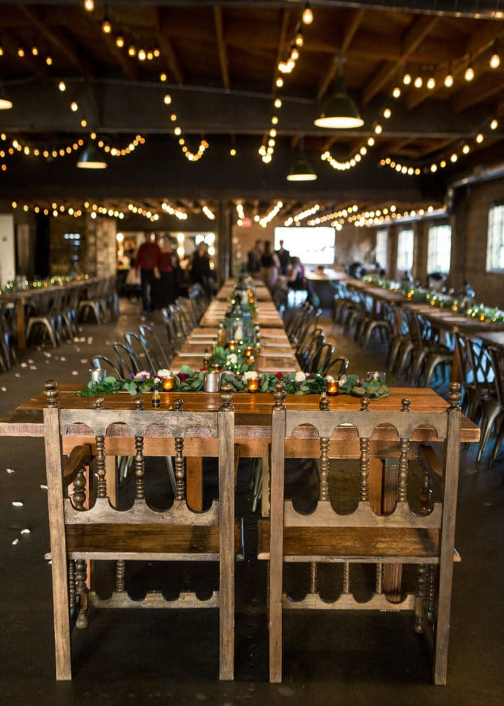 long wooden tables and bistro lights wedding venue los angeles