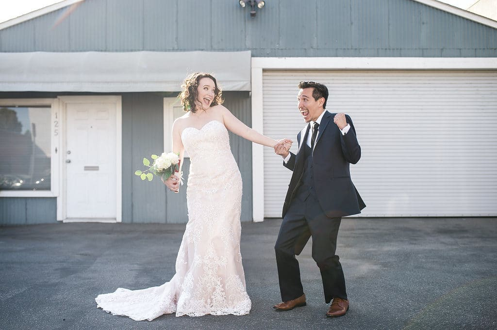 bride and groom dancing silly in los angeles