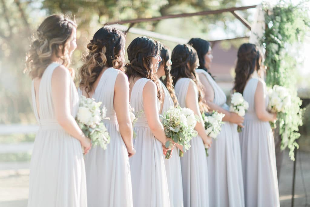 Bridesmaids in lavender grey lined up at the ceremony