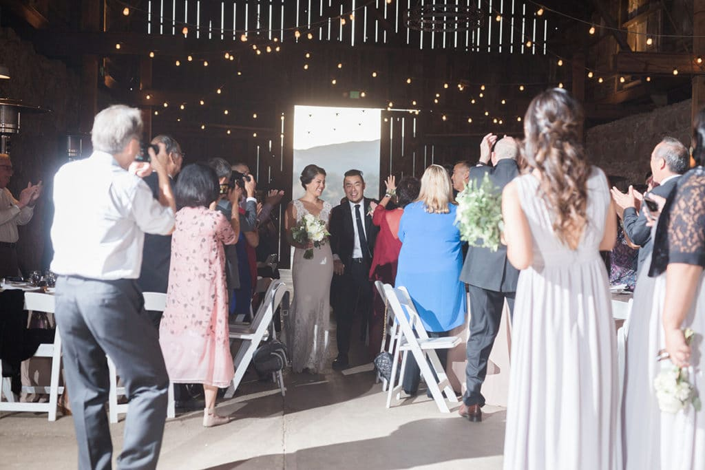 Bride and Groom make their grand entrance into the barn for the reception