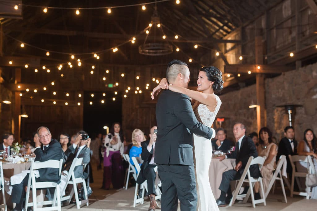 First dance under the lights inside old historic barn