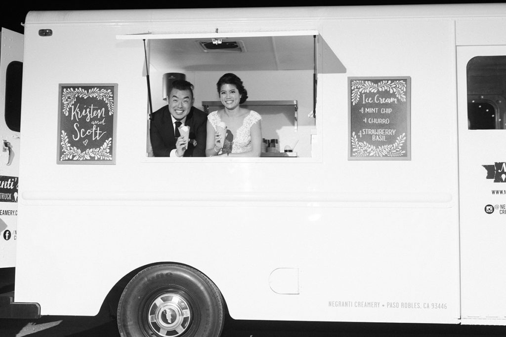 Bride and groom posing inside Ice Cream truck