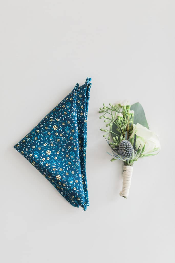 Blue handkerchief with white and green boutonniere for Groom
