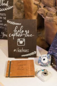 Chalboard sign for the polaroid guestbook and instagram hashtag
