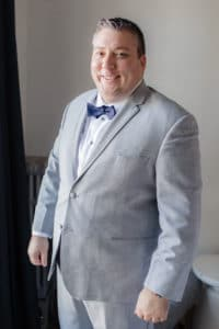 Groom with grey suit and navy bowtie at Palihouse Santa Monica