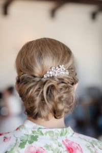 Bride updo with jeweled hair piece and loose curls