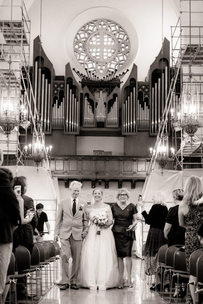 Bride walks down the aisle at the historic St Monica's Catholic Church
